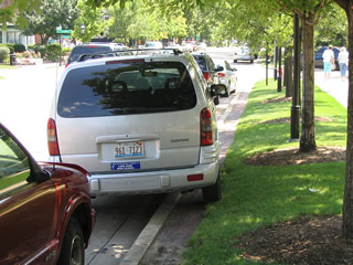 When parallel parking, it is best to leave the curbside wheels: