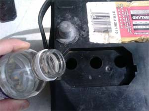 When topping up your battery with distilled water, you should fill: