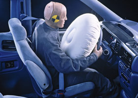 How many inches away should you sit from an air bag?