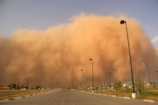 If a dust storm is approaching or you encounter one while driving, you should: