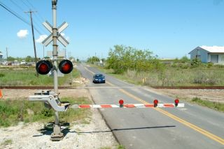 When you approach a railroad crossing, you must stop your vehicle _________ from the nearest rail, if you see an approaching train.
