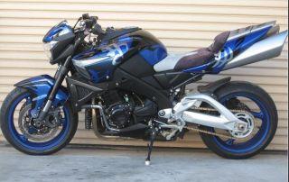 Which female Autobot's vehicle form is a Suzuki B-King motorbike?