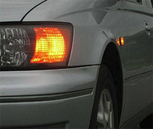 What is the main reason you shouldn't rely on another driver's signal lights to turn?